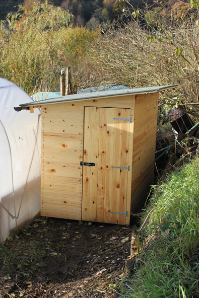 T&G pine wood shed with a felt roof
