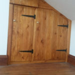 Picture of triangular attic cupboard with T&G doors