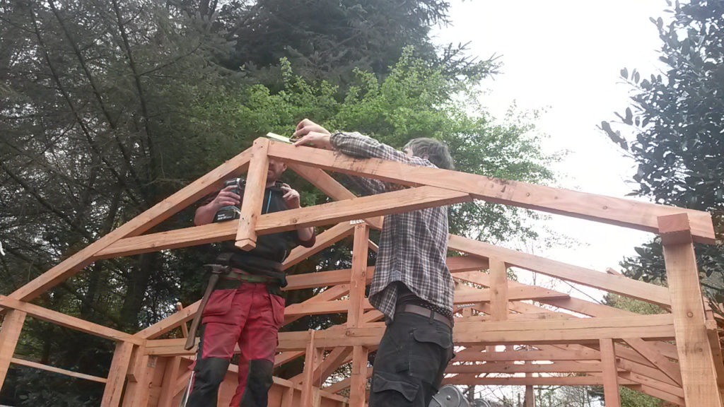 Picture of a two people installing roof joinery