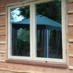 Stromproof double opener window installed in a timber clad building